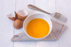 Beaten egg yolks in a bowl with fork Royalty Free Stock Photography