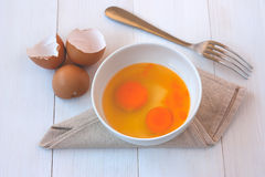 Beaten egg yolks in a bowl with fork Royalty Free Stock Images