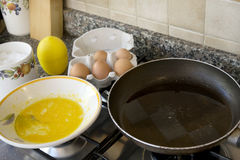 Beaten eggs and pan to prepare an omelette Stock Images