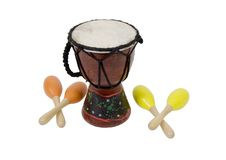 Beaters and shakers. Shown by Aboriginal Djembe native drum with braided cord for a handle with colorful maracas - path included Royalty Free Stock Photos
