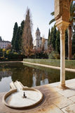 Beatiful architecture of Portico and the reflection in the pool. Granada, Spain - 9 December,2015 :Beatiful architecture of Portico and the reflection in the stock images
