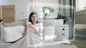 Browsing Internet Using HUD HOlogram Panel. Beatiful brunette girl using futuristic hologram hud panel screen for browsing internet while lying in the bed in the stock illustration