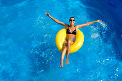 Beatiful Brunette Playing in the Pool. Beauty Brunette at Water Park Royalty Free Stock Photos