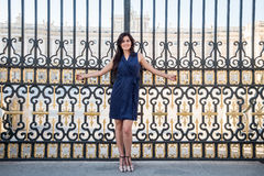 Beatiful brunette woman portrait at a palace's gate Stock Photo