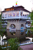 A beatiful building standing on the water. A beatiful building with a caffe standing on the water stock photo