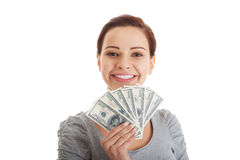 Beatiful casual woman holding money. Royalty Free Stock Photography