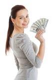 Beatiful casual woman holding money. Stock Photo