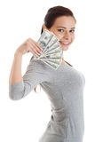 Beatiful casual woman holding money. Royalty Free Stock Photos