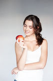 Thoughtful girl holding apple Stock Image