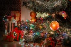 Beatiful christmas decorated tree in shining lights Stock Photo
