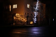 A beatiful christmas decoration on garden on the garden. Some people finally showing us bulbs and decoration again stock image