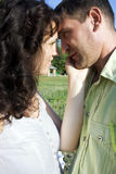 Beatiful couple in love. Beautiful couple in love outdoors looking at each other Royalty Free Stock Photography