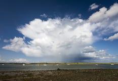 Beatiful deep sky with one oncoming huge cloud. Ireland. Dublin, Malahide royalty free stock photography