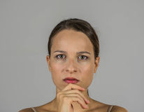 Beatiful girl with upset expression Royalty Free Stock Photos