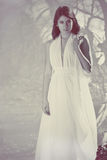 Beatiful girl in white dress. Beautiful sensual girl in white dress black and white royalty free stock photography