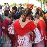 Beatiful girls, Fair in Seville, Feast in Spain. Group of Andalusian women wearing flamenco dress during the Feria of Sevilla, Spain stock images