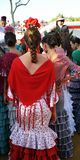 Beatiful girls, Fair in Seville, Feast in Spain. Group of Andalusian women wearing flamenco dress during the Feria of Sevilla, Spain royalty free stock image
