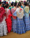 Beatiful girls, Fair in Seville, Feast in Spain. Group of Andalusian women wearing flamenco dress during the Feria of Sevilla, Spain royalty free stock images