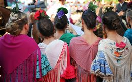 Beatiful girls, Fair in Seville, Feast in Spain. Group of Andalusian women wearing flamenco dress during the Feria of Sevilla, Spain stock photos