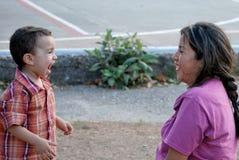 Beatiful Hispanic mother and child. Enjoying each other.  Laughing Royalty Free Stock Photo