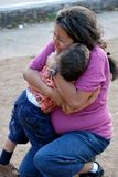 Beatiful Hispanic mother and child hugging. Beautiful Hispanic mother and child hugging each other Royalty Free Stock Photography