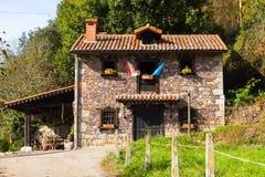 Beatiful house with flags near Paladin, Asturias, Spain Royalty Free Stock Image