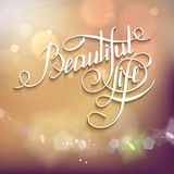 Beatiful Life! - calligraphic words and bokeh. Stock Photography