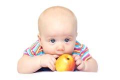 Beatiful little boy with apple. Photo of lying little boy with red-yellow apple Stock Photo