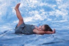 Beatiful little girl lying on the floor playing Stock Images