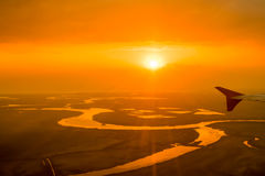 Beatiful orange sunset over the river,captured from aircraft. River Don near the city of Rostov-on-Don,Russia Royalty Free Stock Image
