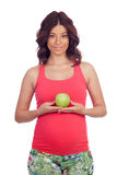 Beatiful pregnant woman with a apple Royalty Free Stock Images
