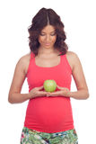 Beatiful pregnant woman with a apple Stock Images