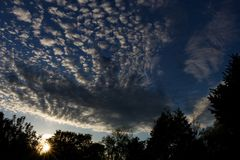 Beatiful Sky. The setting sun lights up the bottom of the clouds stock photography