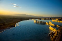 Beatiful sunset in Pamukkale valley. Sunset reflecting over the beautiful white stone cascade in the Pamukkale Stock Photo