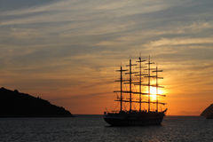 Beatiful sunset. Ship at sea when the sun goes down Stock Images