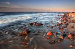Beatiful sunset with  stones in beach Royalty Free Stock Photo