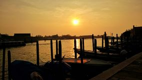 A beatiful sunset in Venice. A vibrant sunset on a dock in Venice, Italy stock images