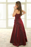 Beatiful Teen in Formal. Teen girl in burgandy formal dress.  Full body standing Royalty Free Stock Photography