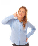 Beatiful woman displaying the call me gesture Stock Photo