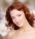 Beatiful woman face with curly hairs Royalty Free Stock Image