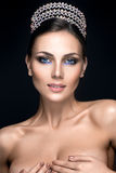 Beatiful woman portrait with crown on head. Beatiful woman portrait with crown on head and gorgeous make up Stock Images