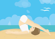Beatiful woman practicing yoga on a beach Stock Photo