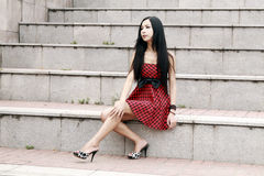 Beatiful woman sitting on stairs. Beatiful woman sitting on stair and poses Royalty Free Stock Photos