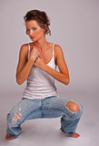 Beatiful woman squating down holding her heart Royalty Free Stock Photo