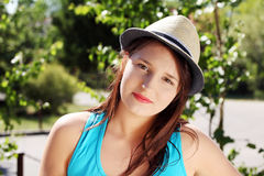 Beatiful woman in summer hat. Stock Photo
