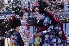 Beatiful  woman and two children  in national Japanese clothes Royalty Free Stock Images
