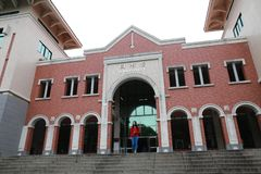 Beatiful woman walk from Library Building in Xiamen University. Library Building of Xiamen University in southeast China. Xiamen University has one of the most stock photo