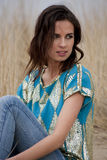 Beatiful woman wearing blue and gold shirt with jeans Royalty Free Stock Photography