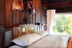 Beatiful wooden bedroom in lanna style, Northern Thailand Royalty Free Stock Photos