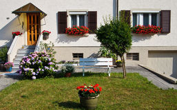 Beatiful yard with flowers in front of the house Stock Photo